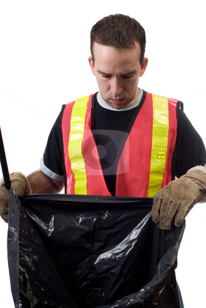 Looking For Garbage stock photo, A young worker wearing a reflective vest is looking inside a garbage bag, isolated against a white background by Richard Nelson