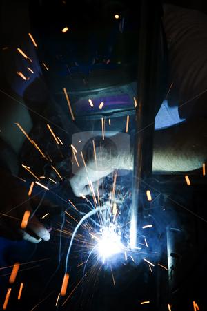 Welder working on motorcycle stock photo, Welder working on the metal fork of a motorcycle by Scott Griessel
