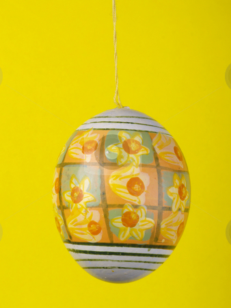 Easter egg stock photo, Handpainted easter egg over yellow by Torsten Lorenz
