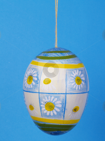 Easter egg stock photo, Handpainted easter egg over blue by Torsten Lorenz
