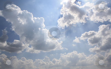 Blue Sky With Clouds stock photo, Blue Sky With Clouds And Sun Rays by Bhavesh Chhatbar