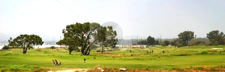 Golf stock photo, Panoramic shot of a golf fairway near Ventura by Henrik Lehnerer