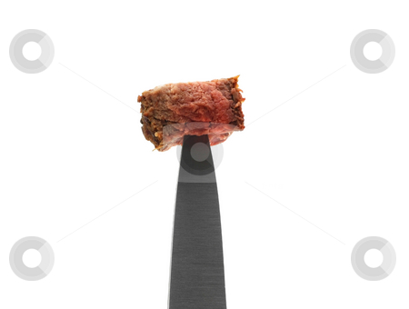 Steak on a knife close up stock photo, Steak on a knife tip close up on white background by John Teeter