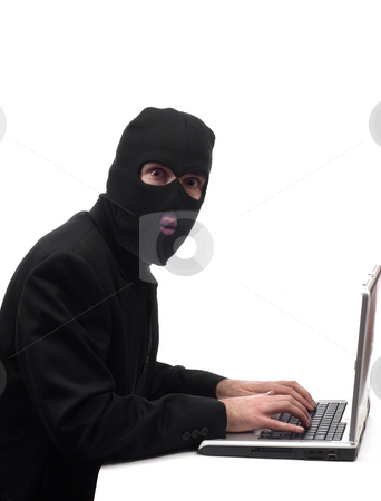 Fraud stock photo, Concept image of a businessman wearing a black balaclava stealing company information by Richard Nelson
