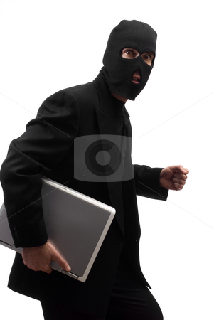 Sneaky Thief stock photo, A sneaky thief wearing a black suit is walking with a laptop, isolated against a white background by Richard Nelson
