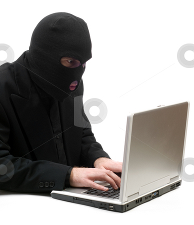 Hacker Typing stock photo, A business hacker is breaking into a laptop computer and stealing information, isolated against a white background by Richard Nelson