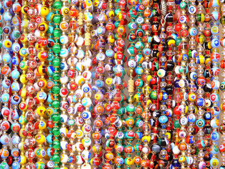 Necklaces cascade stock photo, Coloured necklaces collection by Matteo Malavasi