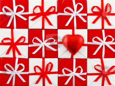 Red and white christmas stock photo, Close up of a large group of red and white gift boxes whit boe and a little red hearth by Matteo Malavasi
