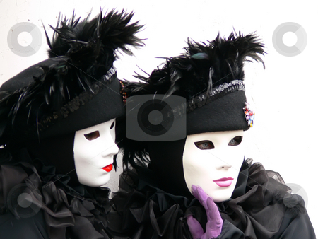 Two Venice black and white masks stock photo, Close-up of 2 venica black masks with purple and red lips by Matteo Malavasi
