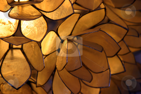 Light Background stock photo, Close up of an orange brown lamp. by Henrik Lehnerer