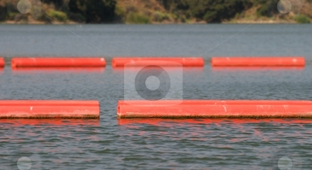 Lake Barriers stock photo, Orange red lake barriers to keep boats out of an area. by Henrik Lehnerer