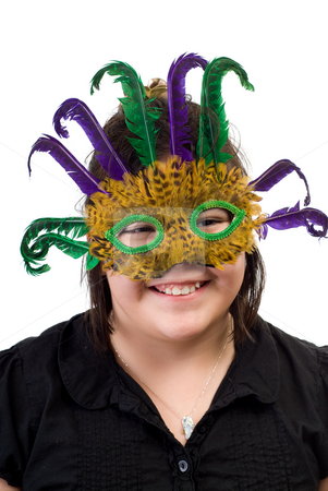 Childrens Mask Party stock photo, A young girl wearing a feather mask, isolated against a white background by Richard Nelson
