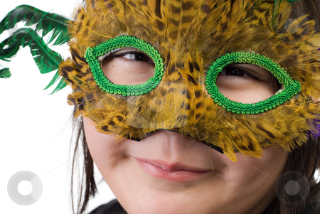 Mardigras stock photo, A young child wearing a Mardigras feather mask, isolated against a white background by Richard Nelson