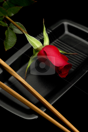 Rose sushi stock photo, Red rose on a japanese black plate with chopsticks over black by Francesco Perre