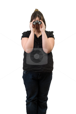 Bird Watching stock photo, A young girl looking through a pair of binoculars is watching a bird eat some bread by Richard Nelson