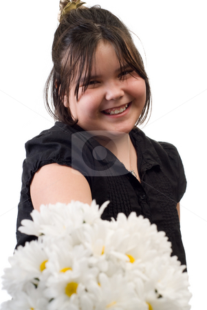 Mother's Day stock photo, A young girl holding out a bouquet of silk daisies out for Mother's Day, isolated against a white background by Richard Nelson