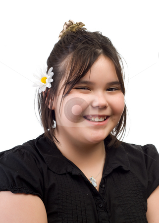 Innocence stock photo, An innocent young girl smiling with a flower in her hair, isolated against a white background by Richard Nelson