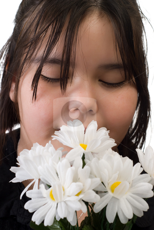Girl Smelling Flowers stock photo, Closeup of a young girl smelling some daisies by Richard Nelson