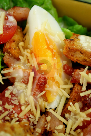 Caesar Salad stock photo, Fresh Caesar salad with lettuce, cherry tomatoes, parmesan cheese, egg, bacon and croutons. by Brett Mulcahy