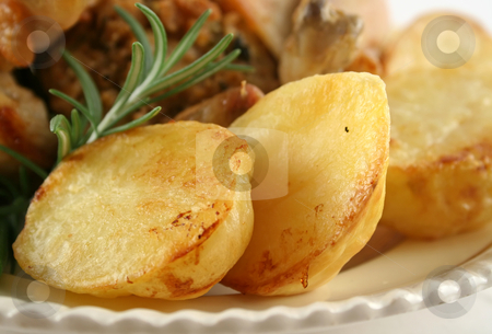 Baked Potatoes stock photo, Baked Potatoes with rosemary ready to be served. by Brett Mulcahy