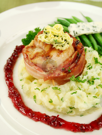 Chicken Mignon stock photo, Chicken fillet mignon on parsley mashed potato with green beans and blue cheese and red wine and raspberry jus. by Brett Mulcahy