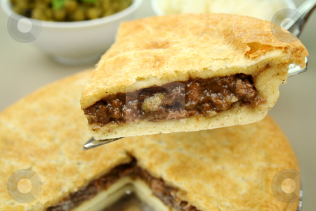 Slice Of Beef Pie stock photo, Slice of beef pie with peas and mashed potato ready to serve. by Brett Mulcahy