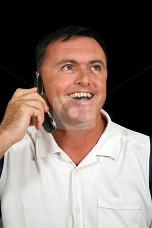 Laughing Cell Phone Man stock photo, Man on cell phone laughing and listening. by Brett Mulcahy