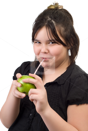 Fresh Apple Juice stock photo, Concept image of a young girl sucking fresh apple juice from a raw apple by Richard Nelson