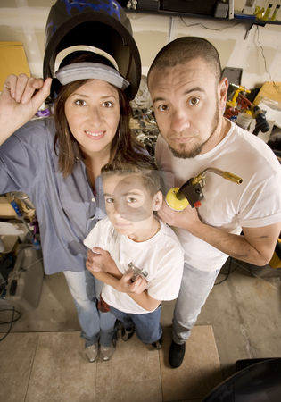 Do-It-Yourself family stock photo, Funny Hispanic family in garage with variety of tools by Scott Griessel
