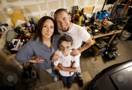 Family in Garage stock photo, Do-it-yourself family in their garage. by Scott Griessel