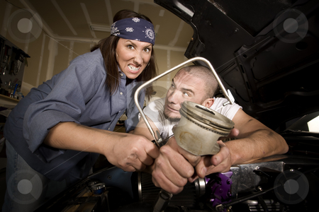 Hapless mechanics stock photo, Hapless mechanics working on car engine with the wrong tools by Scott Griessel