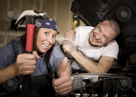 Hapless mechanics stock photo, Hapless mechanics working on car engine with hammers by Scott Griessel