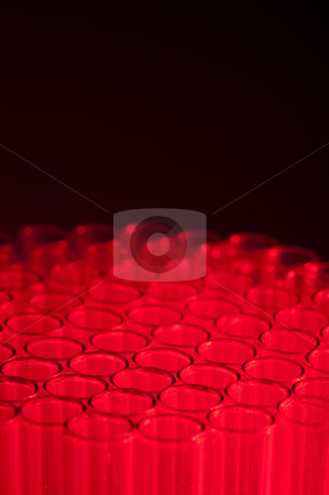 Shallow focus close-up of empty glass test tubes in red stock photo, Shallow focus close-up of empty glass test tubes in red by Vince Clements