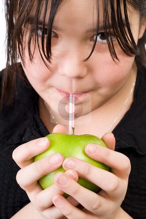 Girl Drinking Apple Juice stock photo, Closeup of a girl drinking fresh apple juice by Richard Nelson