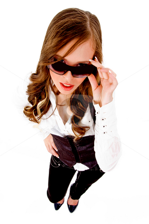 Top view of female holding sunglasses stock photo, Top view of female holding sunglasses with white background by Imagery Majestic