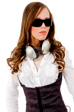 Front view of young beautiful model with headphone stock photo, Front view of young beautiful model with headphone on an isolated white background by Imagery Majestic