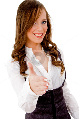 Front view of smiling female offering handshake stock photo, Front view of smiling female offering handshake on an isolated background by Imagery Majestic
