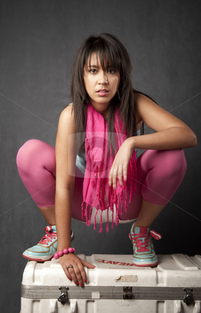 Pretty Young Woman on a Cargo Box stock photo, Pretty young mixed race woman crouched on a cargo bax by Scott Griessel