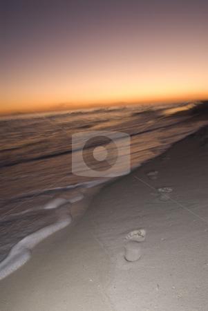 Sunset Footprints stock photo, Footprints along the beach walking towards the setting sun by A Cotton Photo