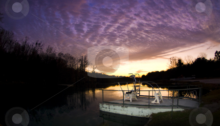 Sunset on Millpond stock photo, A dramatic sunset over the Jackson Blue Springs Millpond in Marianna Florida by A Cotton Photo
