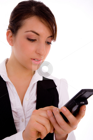 Front view of female executive using cellphone stock photo, Front view of female executive using cellphone against white background by Imagery Majestic