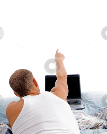 Man with laptop on white background stock photo, Laying indicating man with laptop on an isolated white background by Imagery Majestic