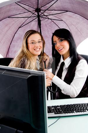 Executives holding umbrella stock photo, Executives holding umbrella on an isolated white background by Imagery Majestic