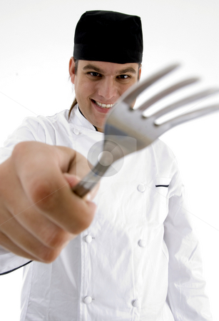 Close up view of fork holding chef stock photo, Close up view of fork holding chef with white background by Imagery Majestic
