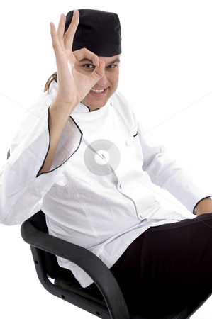 Handsome chef with okay hand gesture stock photo, Handsome chef with okay hand gesture on an isolated white background by Imagery Majestic