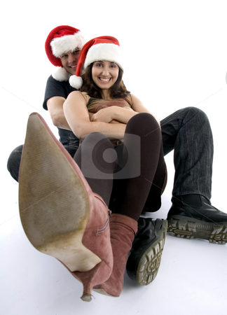 Posing couple with long legs in front of camera stock photo, Posing couple with long legs in front of camera on an isolated white background by Imagery Majestic