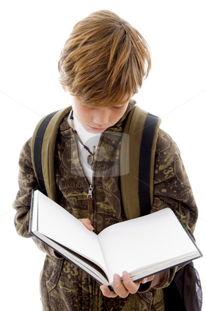 Front view of school child reading  stock photo, Front view of school child reading with white background by Imagery Majestic
