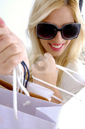 Woman holding shopping bags stock photo, High angle view of woman holding shopping bags with white background by Imagery Majestic