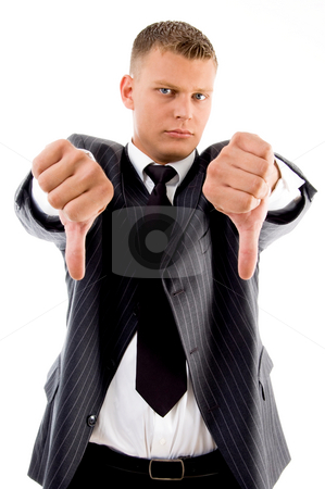 Standing professional with thumbs down  stock photo, Standing professional with thumbs down with white background by Imagery Majestic