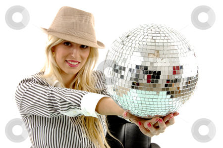 Portrait of smiling woman showing disco ball stock photo, Portrait of smiling woman showing disco ball against white background by Imagery Majestic
